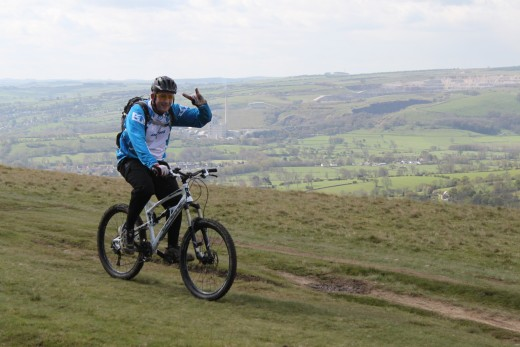 How to burn calories cycling- and have fun too like this mountain biker on Win Hill in the Peak District.