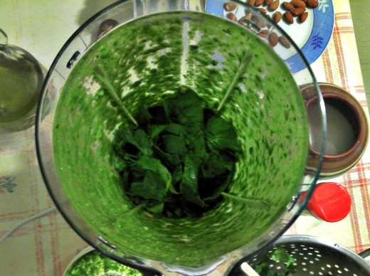 After the first mix,  adding more spinach