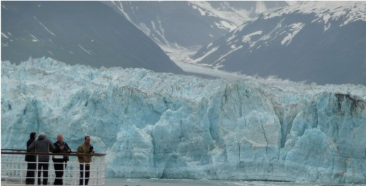 Close to the Hubbard Glacier passengers feel the cold from the river of ice and see small icebergs that have broken off.