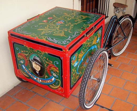 A much loved tricycle, with a picture of Carlos Gardel included in the fileteado art.