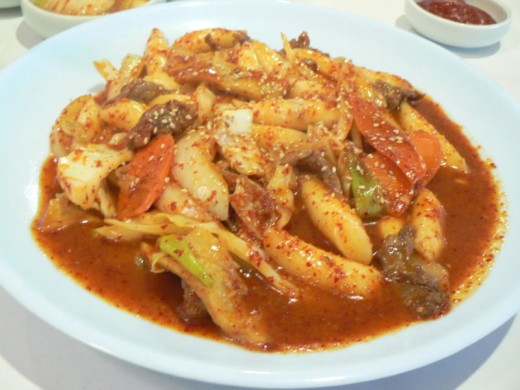 Ddeokbokki is a Korean dish prepared from sautéed rice cakes with vegetables and pork. The ingredients (reactants) are carefully combined (chemically) in the presence of heat (thermal energy) to form the tasty food (product).