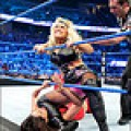 """The old """"get choked on the ropes"""" move. Always a crowd favorite in female wrestling."""
