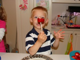 Alex is excited to get his first strawberry on his stick!