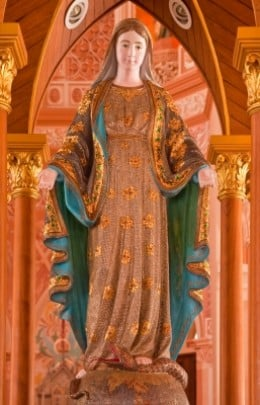 A Holy Mary statue decorated with jewels.  A divine figure often associated with miracles.