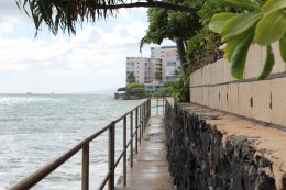 This concrete walkway connects Leahi and Mākālei Beach Parks, but is unsafe at high tide.