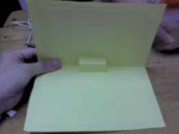 Lower down the top card and it will automatically stick to the top part of yellow construction paper