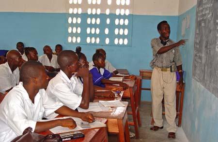 A Teacher, teaching in a Classroom at a secondary school in Pendembu, Sierra Leone.