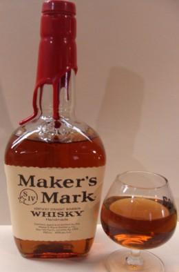 Bottle and glass of Maker's Mark bourbon.