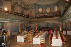 A layout similar to those used by the early music halls, tables arranged on the main floor and a stage for the entertainment.