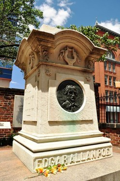 Edgar Allan Poe's grave marker in Westminster Hall and Burying Ground, Baltimore MD. Cognac and three roses sometimes appear at this site, but the media report that this is likely the work of a Poe Toaster copycat.