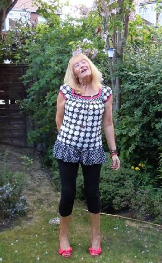 Sheila Newton standing in her home garden.