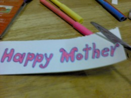 "Write ""Happy Mother's Day"" and color them with markers"