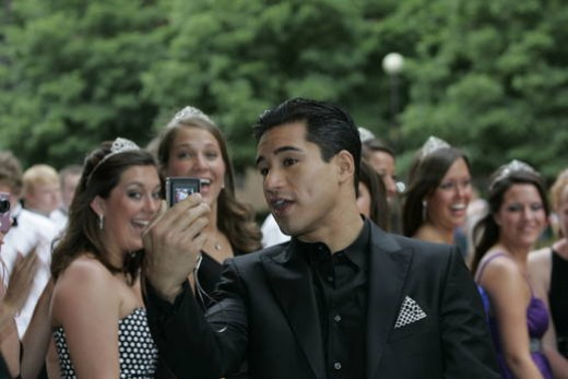 Mario Lopez snaps pics before the Snake Pit Ball