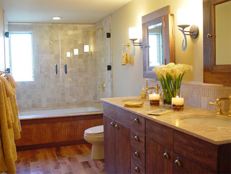 Country style bathroom in a western style home equipped with marble counters, plants, and laminate flooring.
