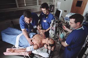 Anesthesia trainees learning on a simulated patient. These simulations are often used to teach emergency intervention in life-threatening situations. (creative commons license).