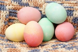COLORED EGGS ON CROCHET by Eperceptions  DESCRIPTIONColorful pastel Easter eggs on handmade crocheted blanket background.