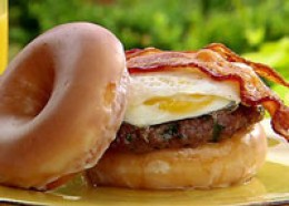 Paula Deen's Bacon Egg Buger Sandwiched Between Two Glazed Donuts