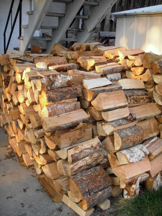 A cord of firewood is a measure of volume: four feet by four feet by eight feet. We burn fires for comfort and atmosphere in the evenings in the living room, not as a main source of heat.  A cord lasts us two winters.