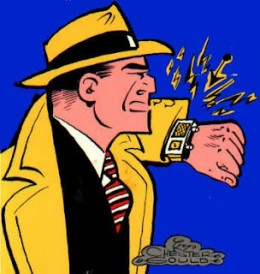 Dick Tracy talking into his watch.