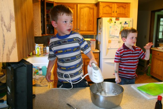 Whoa - Daddy came home from work as Matt was mixing the whipped cream. They look a little surprised!