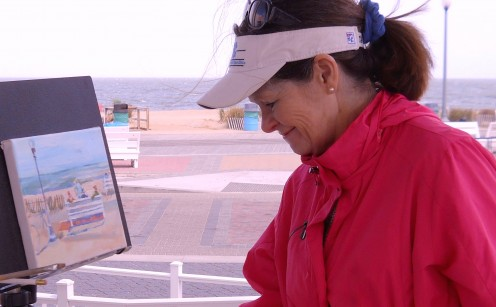 Plein Air Coastal Delaware artist, Christine Heyse, painting a Rehoboth Beach Boardwalk  scene.