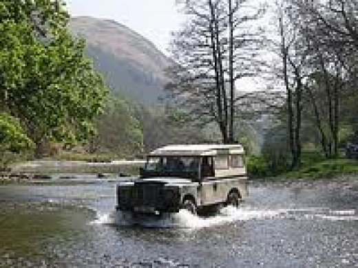 Off-roading. This isn't mine, I have to tell you. The widest river I forded was less than a quarter of this! Nice bow-wave, constant speed and keep going and you won't get stuck.