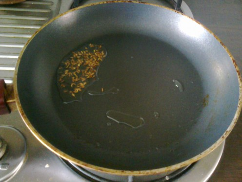 Heat oil and add cumin seeds.
