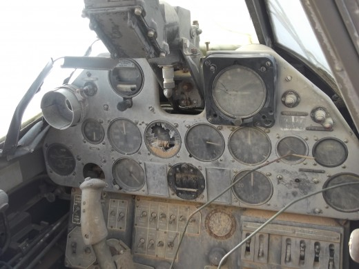 The instrument panel is remarkably intact after since the pilot's disappearance in 1942.  Black box at top of panel is the electrical gunsight used by the pilot to aim machine-gun fire and bombs at targets.