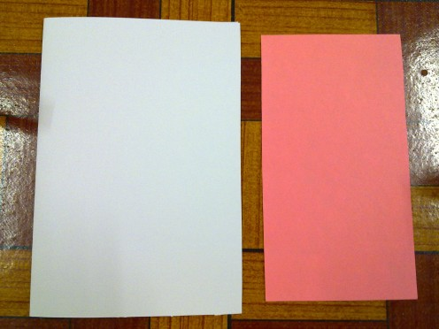 Fold the white card into half. Cut out the light pink paper, slightly smaller than the white card