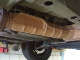 Although this looks rusty, it is just discolored because it is the front muffler close to the catalytic converter (which cleans the emission from the exhaust system)It is close to the very hot exhaust manifold on the cylinder head of the motor. This