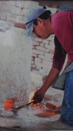 Wax burning out in the oven. This process of wax disintegration leaves the capsule free to be occupied by the bronze.