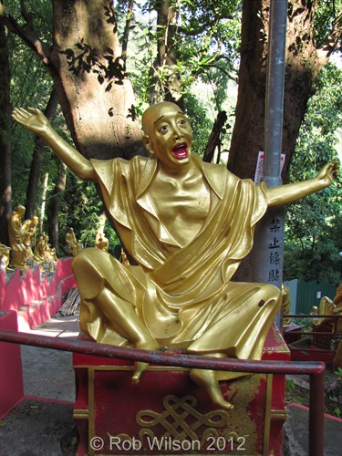 "My favourite statue at the Monastery of the 10,000 Buddha's the ""Thank God it's Friday"" statue"