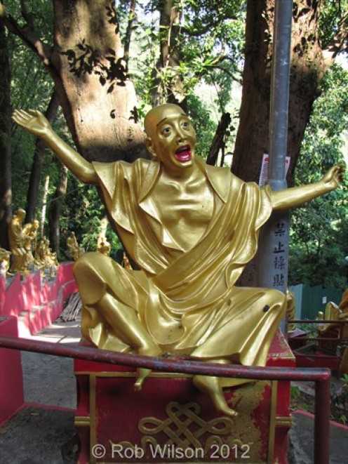 """My favourite statue at the Monastery of the 10,000 Buddha's the """"Thank God it's Friday"""" statue"""