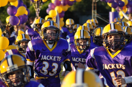 My son #33 and the Rest of his Youth football teammates take the field for a game.