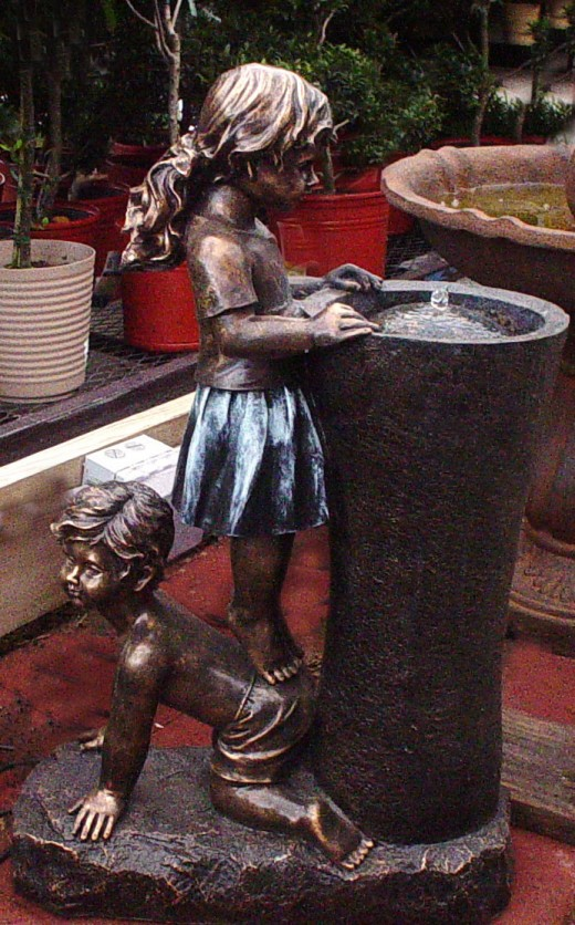 Playful fountains. How great would this be for the children's flower garden!