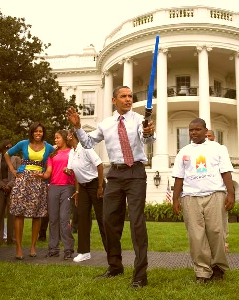 President Obama wields a light sabre in this candid photo.