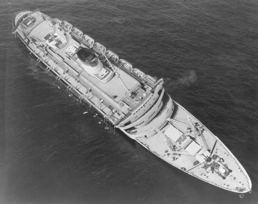 Andrea Doria begins to list after the collision