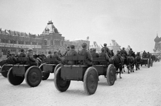 Soviet troops parade in Red Square before being sent to the front line