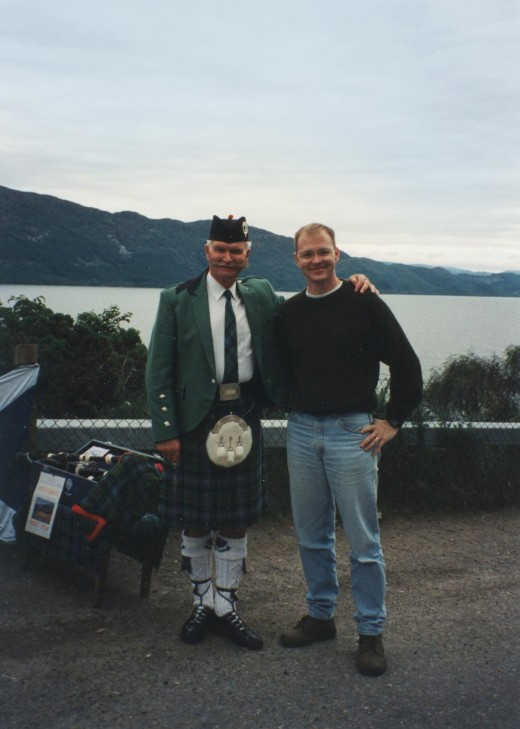 Bill next to Murdo, the lone piper on the banks of Loch Ness.