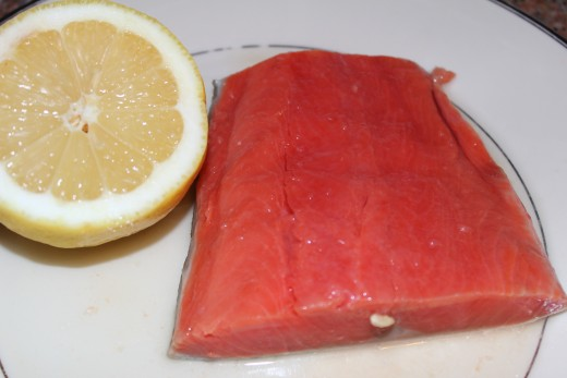 Squeezing fresh lemon on a 6 ounce boneless salmon steak brings out itʻs flavor.