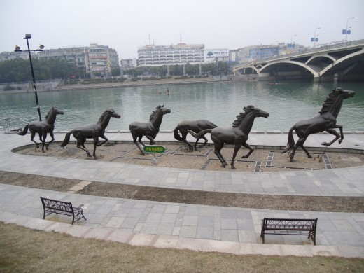 Statues of Horses Running next to one of the Rivers in Guilin