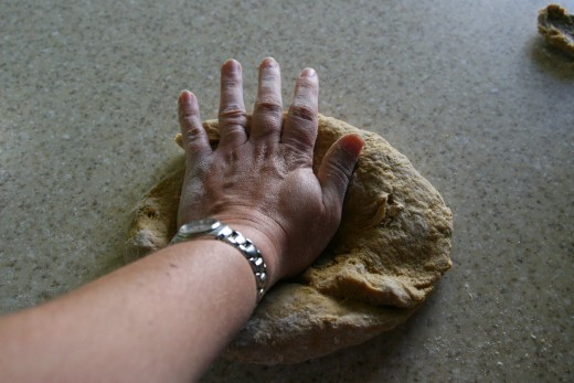 Press the dough out with your hand.