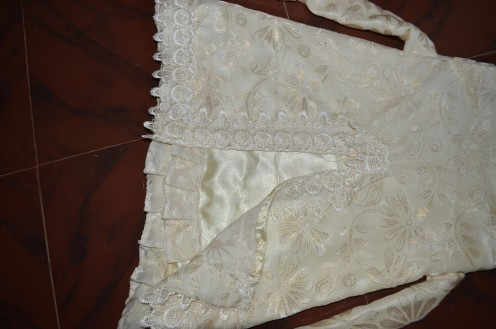 The bottom portion with the frills in the satin lining