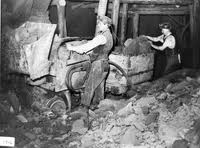 Underground - miners with their 'cranners', - mine wagons - full of ironstone