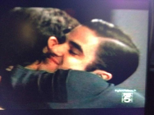 Blaine and Cooper sing and hug it out.