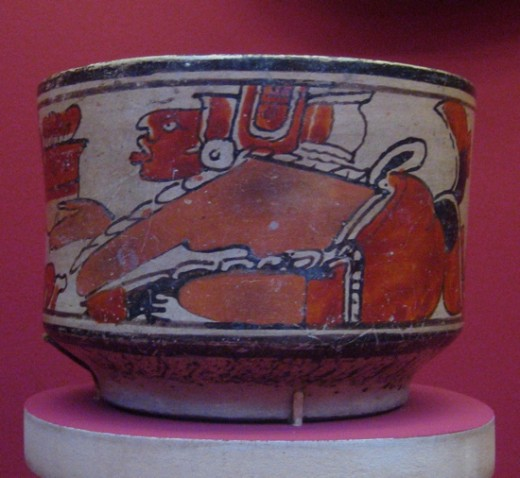 Guatemala Highlands, Maya Bowl with Images of Humans with Bundled Offerings, A.D. 600-900 Ceramic, Slip-painted ceramic, Height: 6 in. (15.24 cm) Gift of the Art Museum Council in honor of the museum's twenty-fifth anniversary (M.90.168.10)