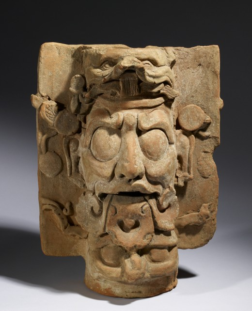 "Made up of smoothed sheets and coils of coarse orange clay, this ""incensario,"" or incense burner, depicts one of the Palenque Triad of deities that art historians call ""GIII."" The Maya called him Kinich Ajaw, or ""Sun Lord."" He is shown here with his"