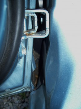 Here's a closer look. That gap there loves to collect leaves and dirt and then rot through the rocker panels.
