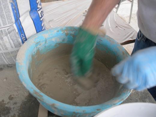 Mixing a small batch on concrete