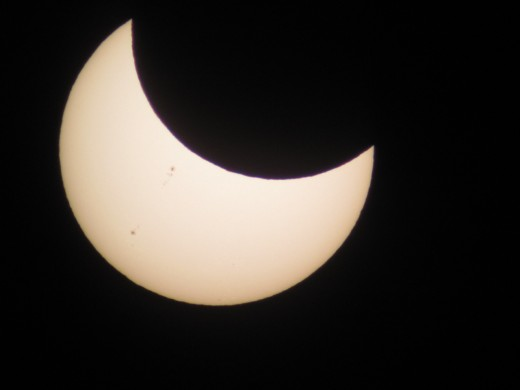 Wish I'd figured out this camera setting earlier. 7:11 PST. Click to view larger size with sunspots clearly visible!